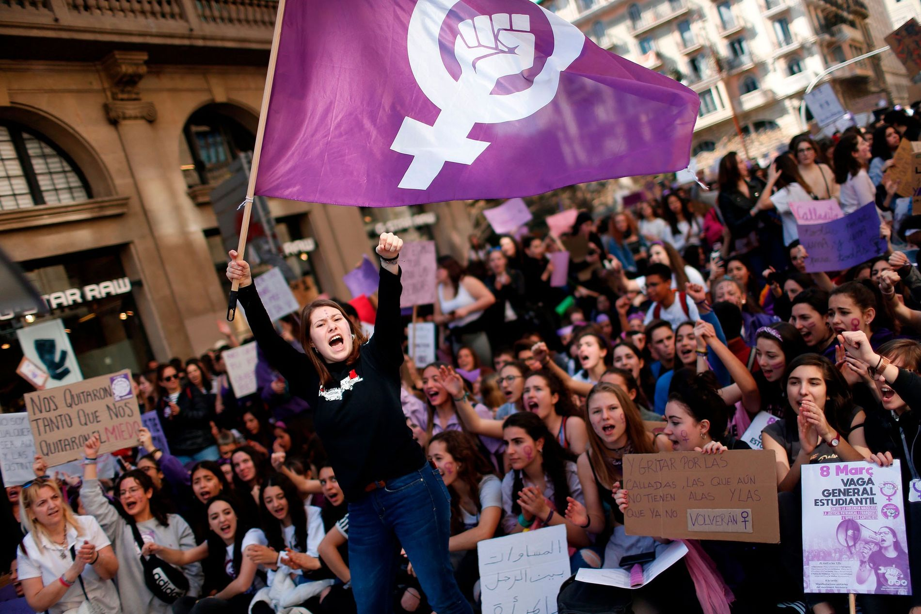 Women around the world, like this demonstrator in Barcelona, take to the streets to demand equal ...