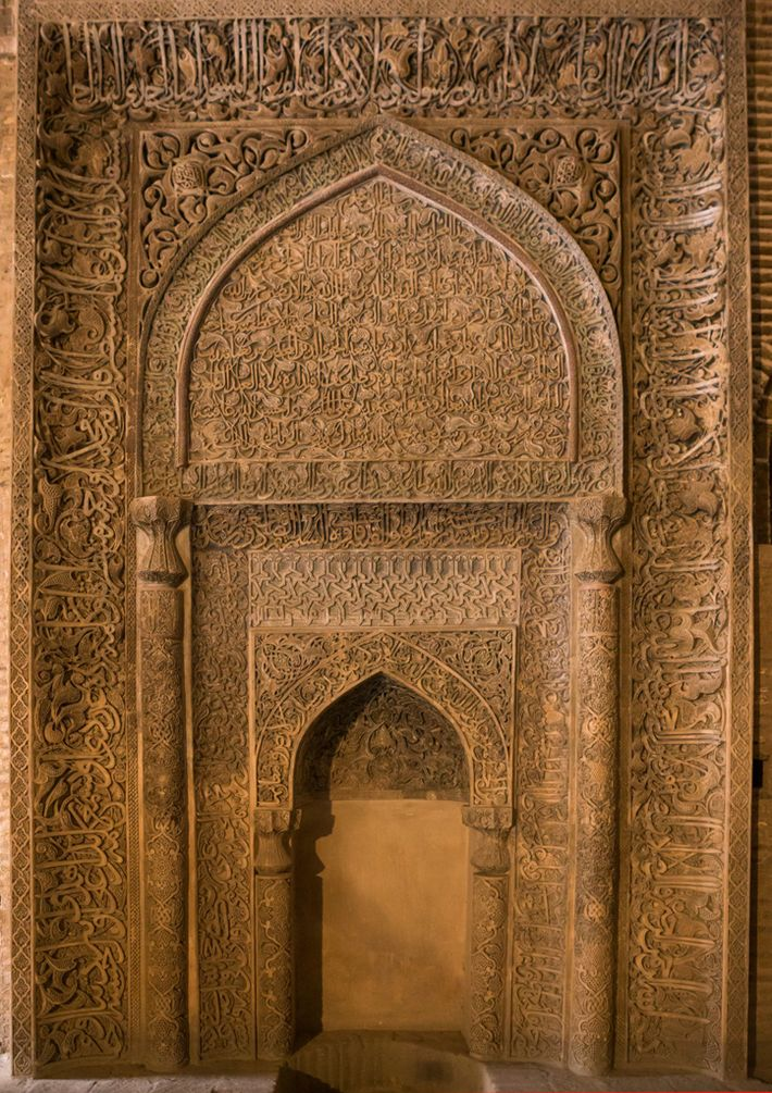 This elaborately carved mihrab in Ishfahan's Friday Mosque points the worshippers' way to Mecca. The mosque, ...