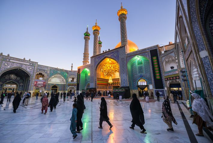 Worshippers gather in the courtyard of the Fatima Masumeh Shrine in the city of Qom. Originally ...