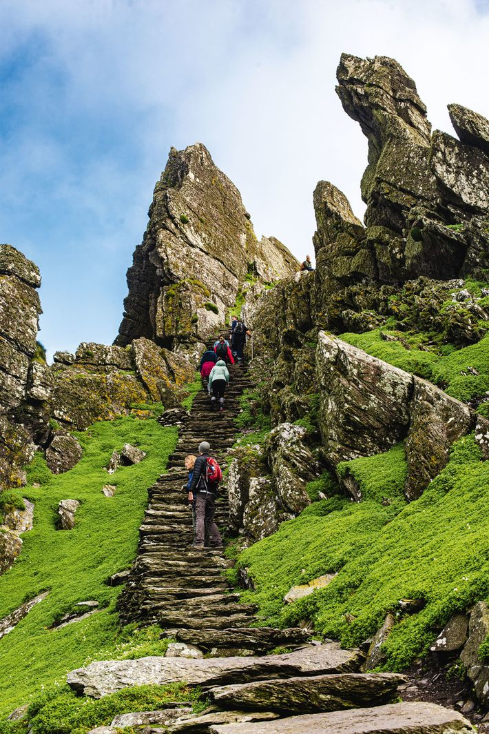 Visitors scale treacherous steps on Skellig Michael known as 'the way of Christ'.