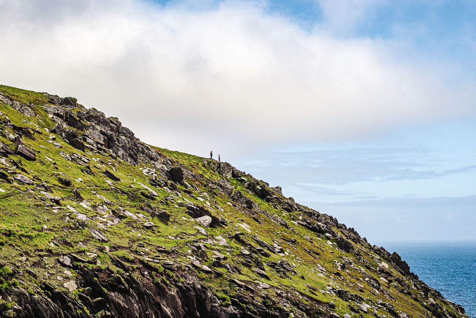 Walkers scale the cliffs of Dunmore Head, Dingle Peninsula.