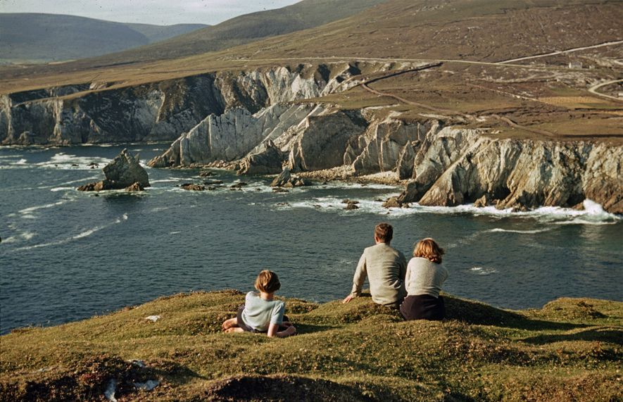 People relax along the rugged coastline of Achill Island, Ireland, back in 1940.