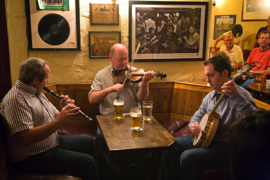 Musicians play traditional Irish tunes at Gus O'Connor's pub in Doolin.