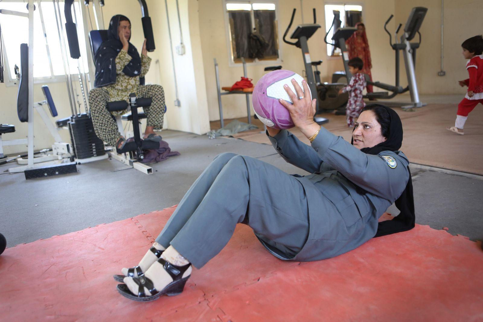 Islam Bibi in the gym, Afghanistan, 2012. Bibi, a mother of three, joined the police in ...