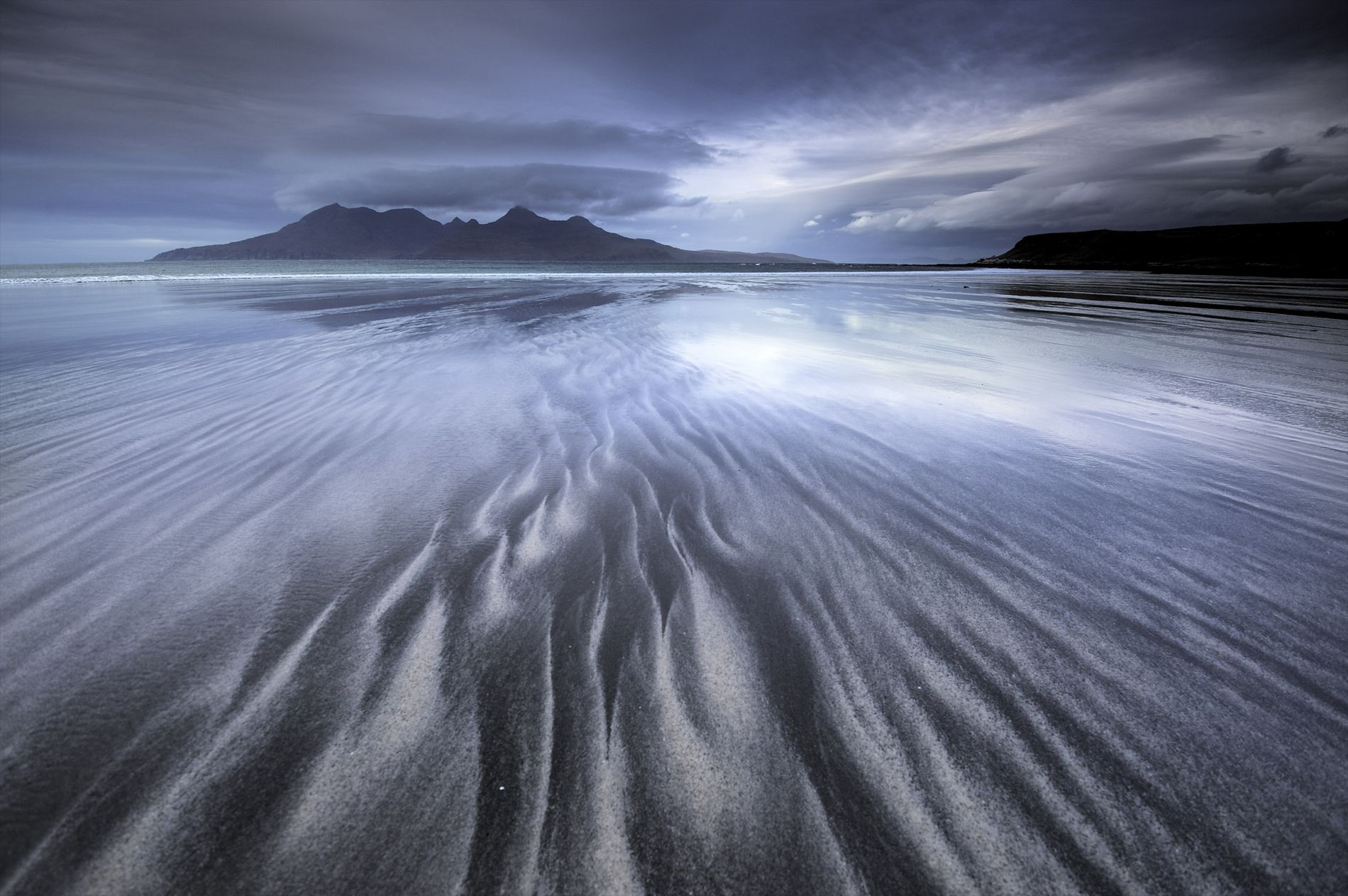 Looking out at the Isle of Rum from Laig Bay on the Isle of Eigg. The ...