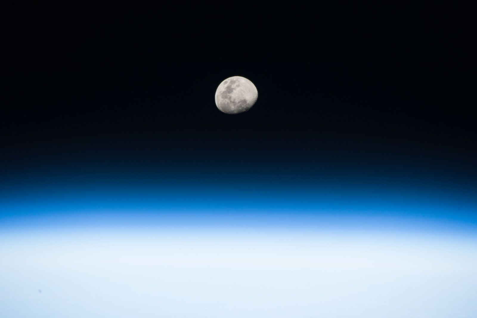 NASA astronaut Randy Bresnik took this image of the rising Moon from aboard the International Space ...