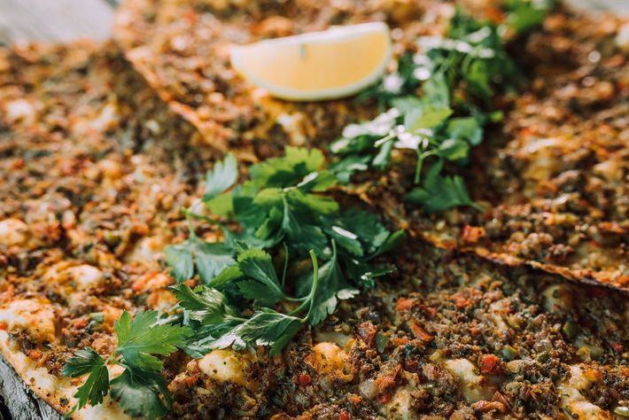Lahmacun — Turkey's answer to pizza — is a crispy, round flatbread topped with a thin layer ...