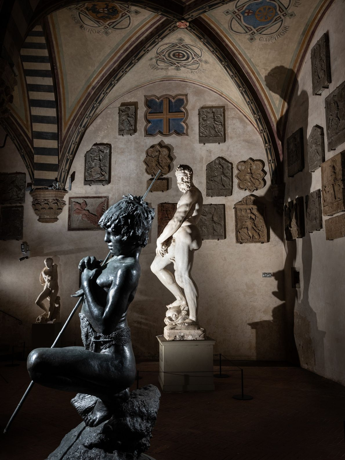 Gianbologna's weary Oceanus (1585) looks on Fisher Boy (Vincenzo Gemito, 1874) in the Bargello Museum.