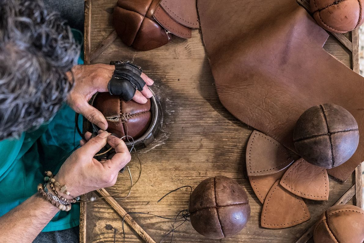 In the village of Treia, craftsman Daniele Rango makes a bracciale ball in his workshop.