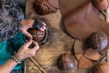 In the village of Treia, craftsman Daniele Rango makes a bracciale ball in his workshop.