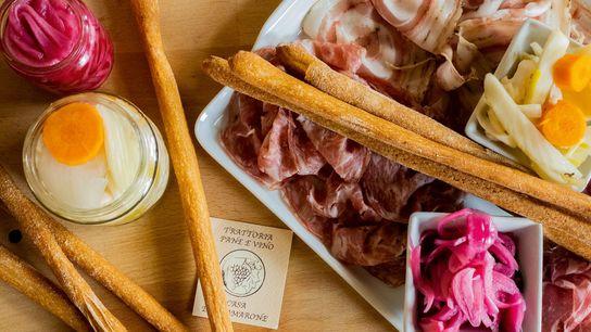 Grissini, charcuterie and pickled vegetables at Trattoria Pane e Vino in Verona, Veneto.