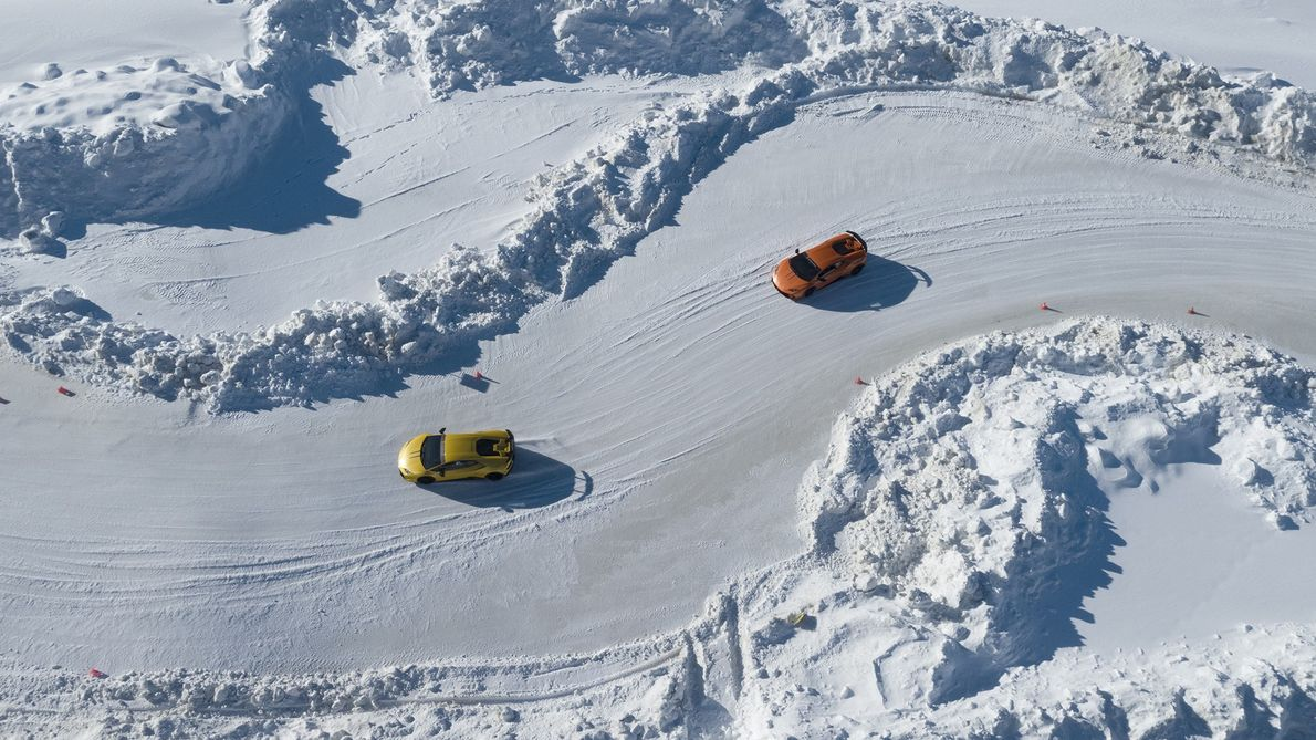 Italy: two Lamborghini supercars race along a frozen ice track. The experience has become popular with ...