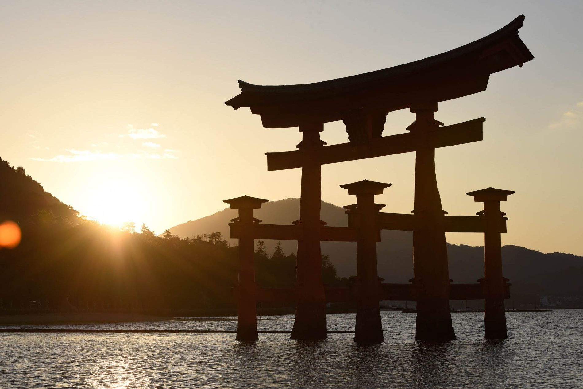 The bright orange Grand Torii Gate stands in the Seto Inland Sea at about 55 feet ...