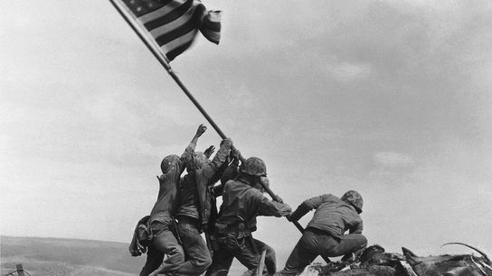 After five days of ferocious fighting, U.S. Marines raise the American flag atop Iwo Jima's highest ...