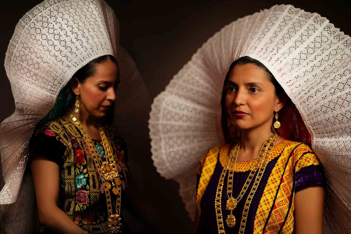 """Two sisters are adorned by a bidani roo, commonly known as """"glow"""" or """"little face"""" in ..."""