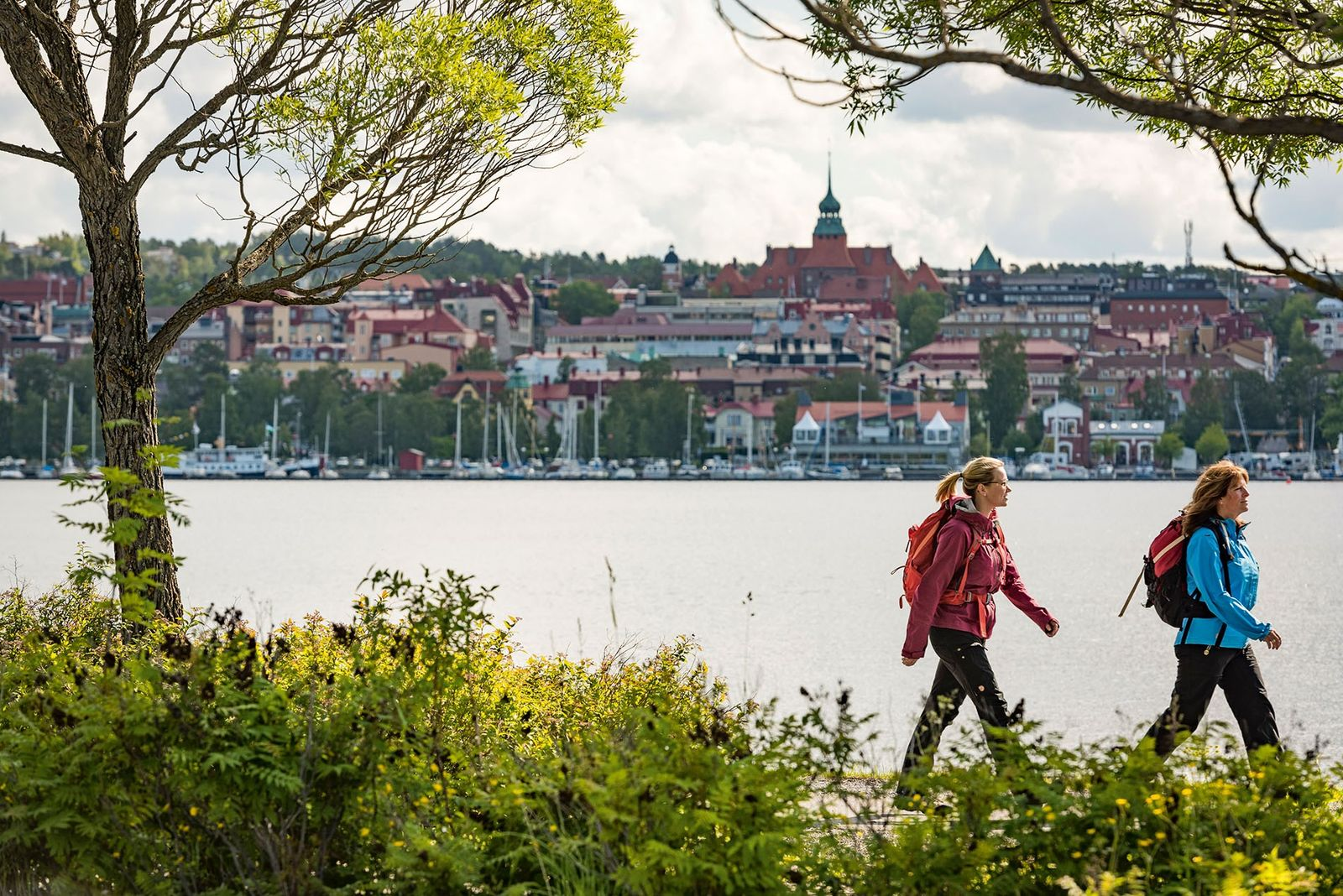 Walking along the shores of Lake Storsjön with the city of Östersund in the background.