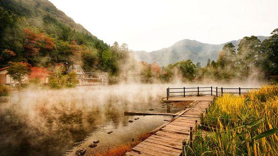 Wooden walkways extend over an onsen in Beppu in Japan's Oita region.