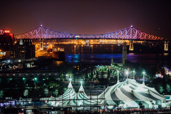 The Jacques Cartier Bridge illuminated at night and reflects the city's changing seasons with an ambient ...