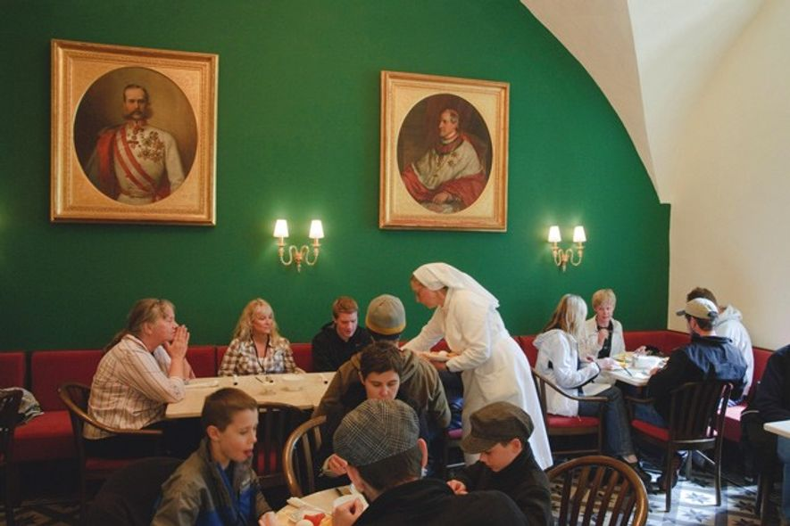 Nuns and visitors eatings at the Austrian Hopsice of the Holy Family. Credit: Noam Chen, Israeli ...