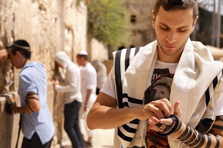 Pilgrim at the Western Wall. Credit: Noam Chen, Israeli Ministry of Tourism