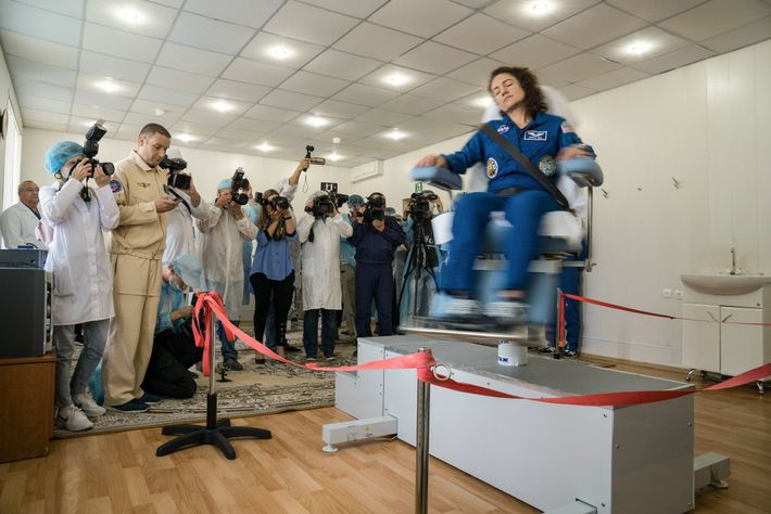 NASA astronaut Jessica Meir takes a spin in a rotating chair to test her vestibular system ...