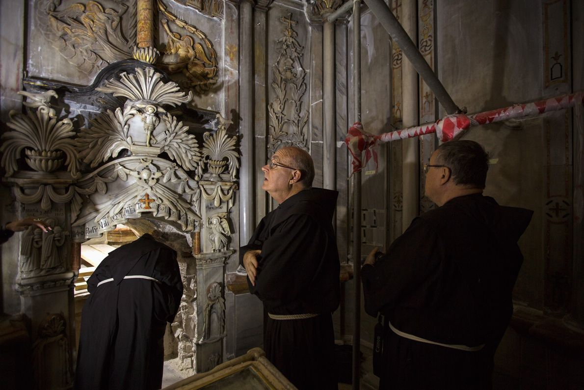 Franciscan priests visit the traditional site of Jesus's tomb during its renovation in the Church of ...