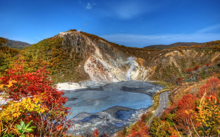 Colorful foliage surrounds Oyunuma Lake in Jigoku-Dani, Noboribetsu, Japan. The thermal hot springs are a popular ...