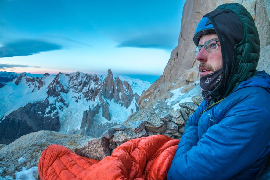 Reynolds enjoys the sky show while bivied high on the shoulder of Aguja Poincenot in January ...