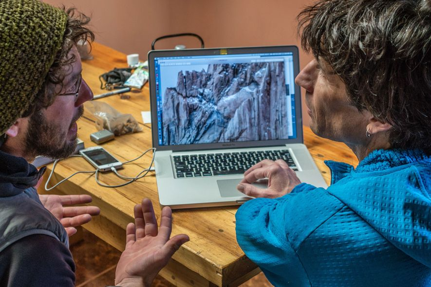 Reynolds (left) and Patagonia climbing expert and author Rolo Garibotti examine the climber's route.
