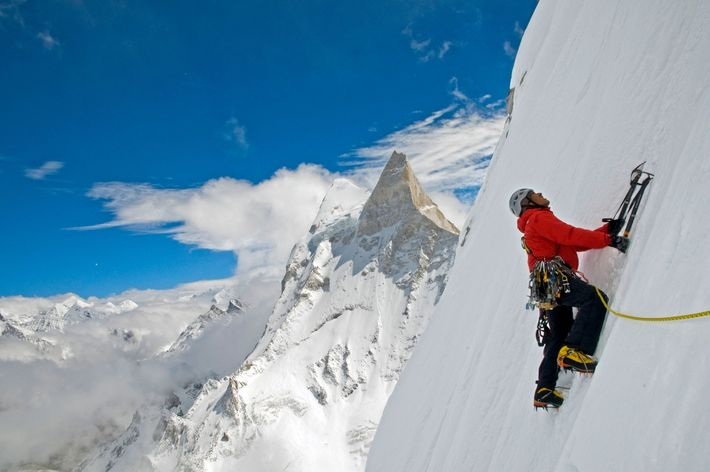 Chin climbs an ice wall while working toward the first ascent of the Shark's Fin on ...