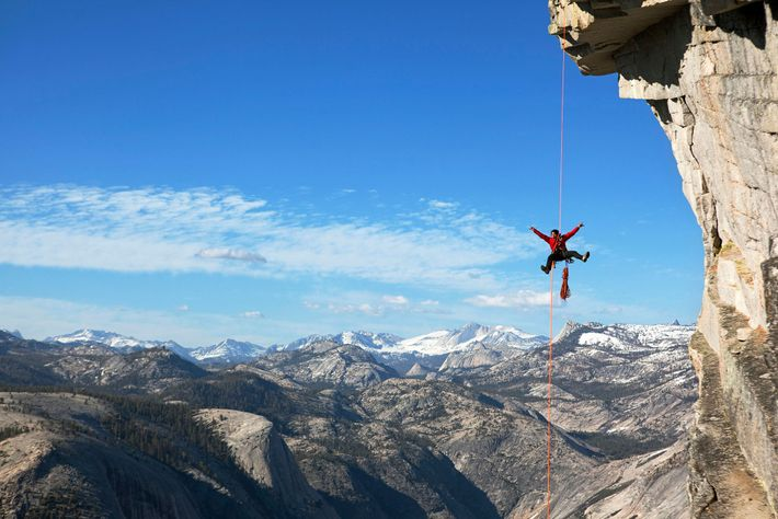 Expert climber and adventure photographer Jimmy Chin extends his limbs while hanging from a rope in ...