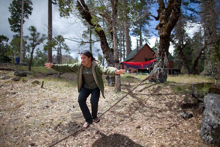 Chin balances on a slackline at a campsite in California's Yosemite National Park.