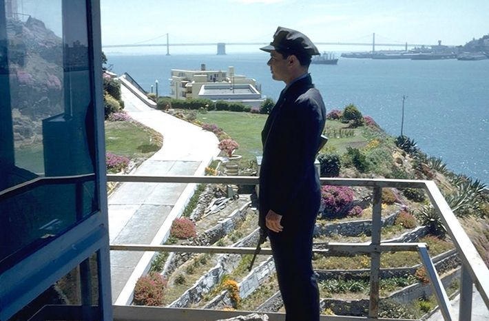 This photo (ca. 1962) shows an unknown officer overlooking the terrace garden, often tended by prisoners. ...