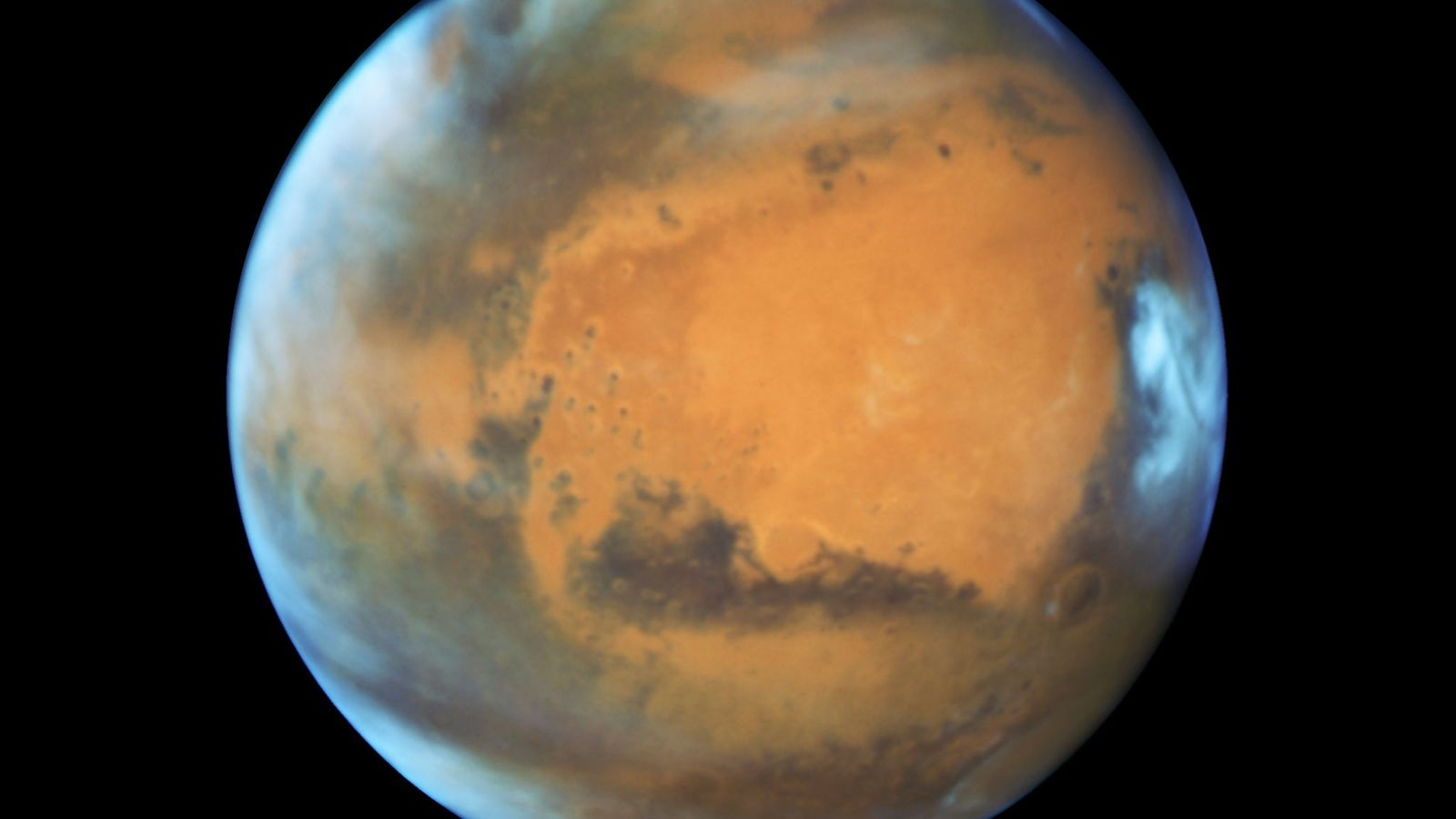 Surface features on Mars come into focus in this Hubble Space Telescope picture taken during a ...