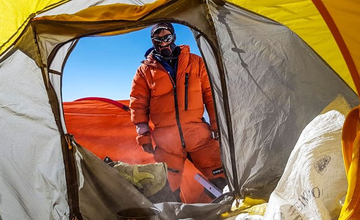 A member of Txikon's team surveys the tents set up at Camp 2. The expeditions must ...