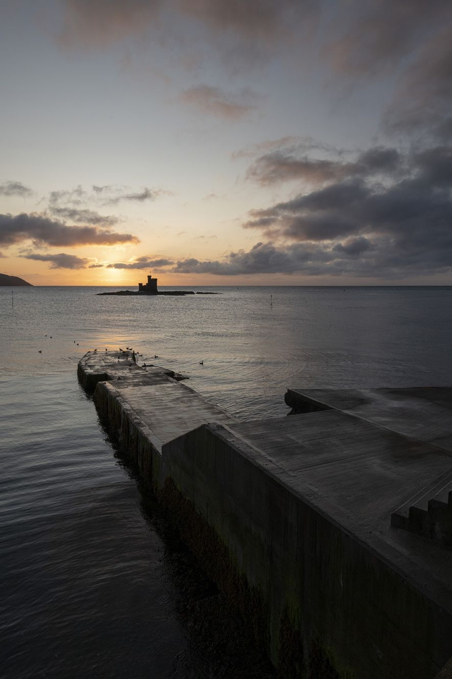Dawn from Douglas seafront, overlooking St Mary's Isle and its Tower of Refuge. This structure was ...