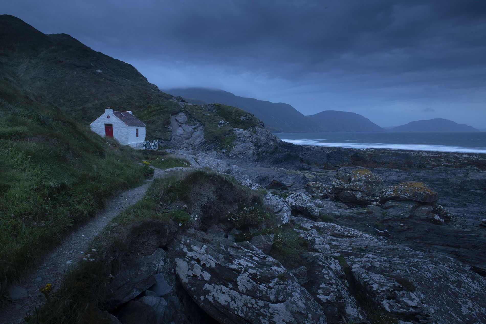 Niarbyl Bay, by twilight, on the Island's west coast. Beaches like this are cleaned by local ...