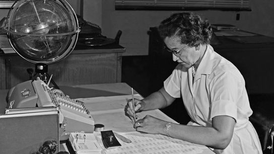 NASA space scientist and mathematician Katherine Johnson, pictured here in 1962, was known as a human ...