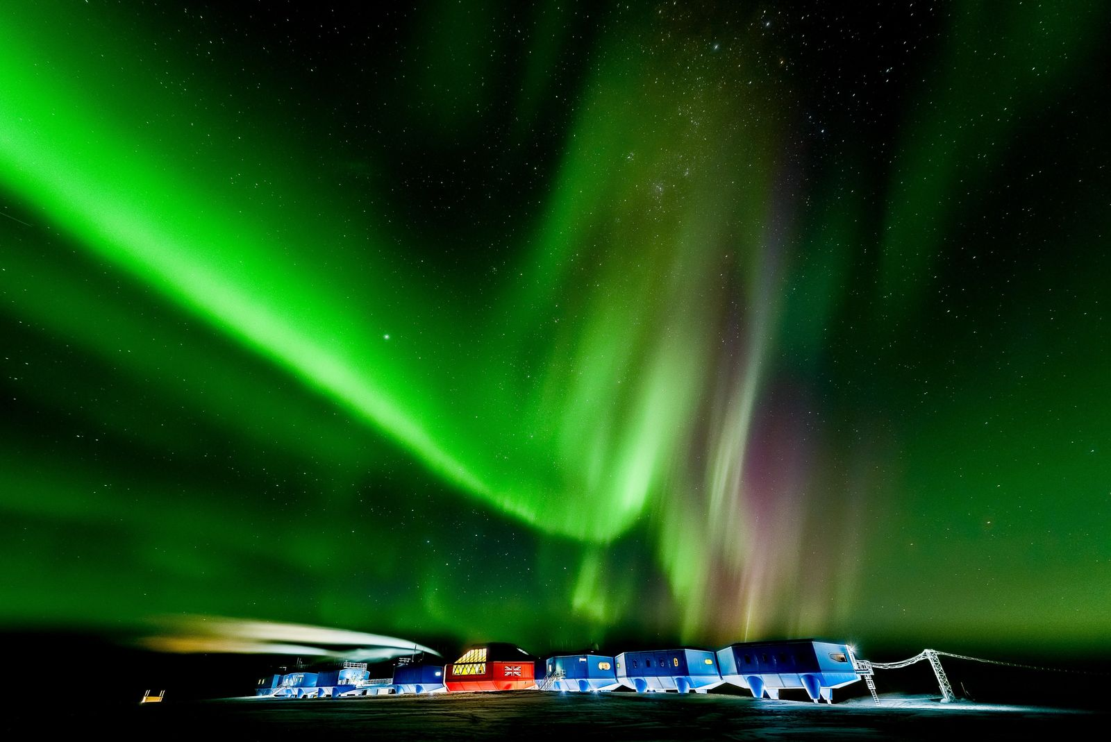 The aurora australis lights up the southern skies above Halley VI during winter, 2016. Halley VI is the ...