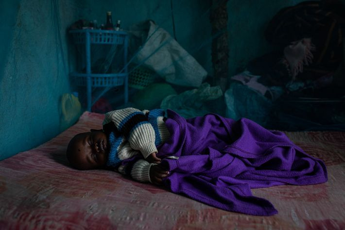 Ten-month-old Prince Jackson sleeps under a mosquito net at his home in Kakamega County, Kenya. He's ...