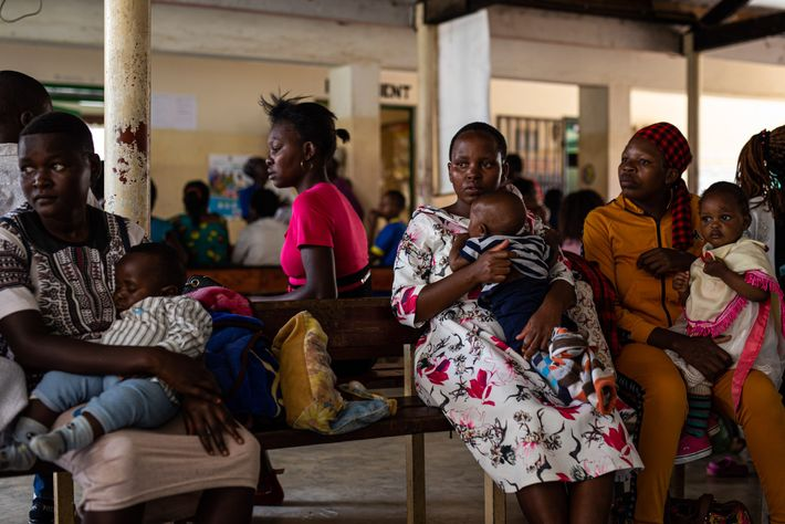 Women wait at Iguhu District Hospital in western Kenya so that their babies can receive the ...