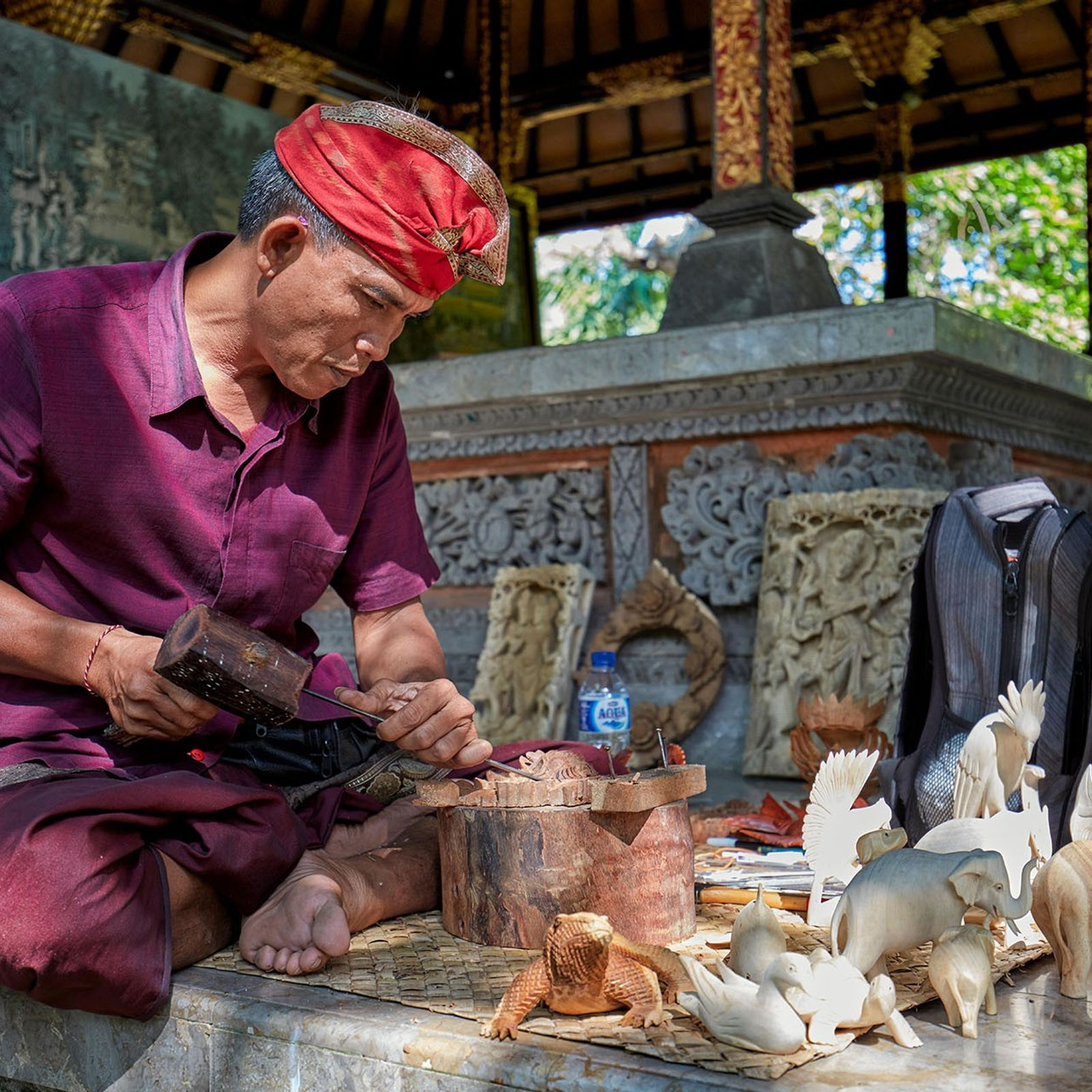 Craftsman carving wood at the Agung Rai Museum of Art (ARMA) in Ubud, an atmospheric one-stop-shop ...