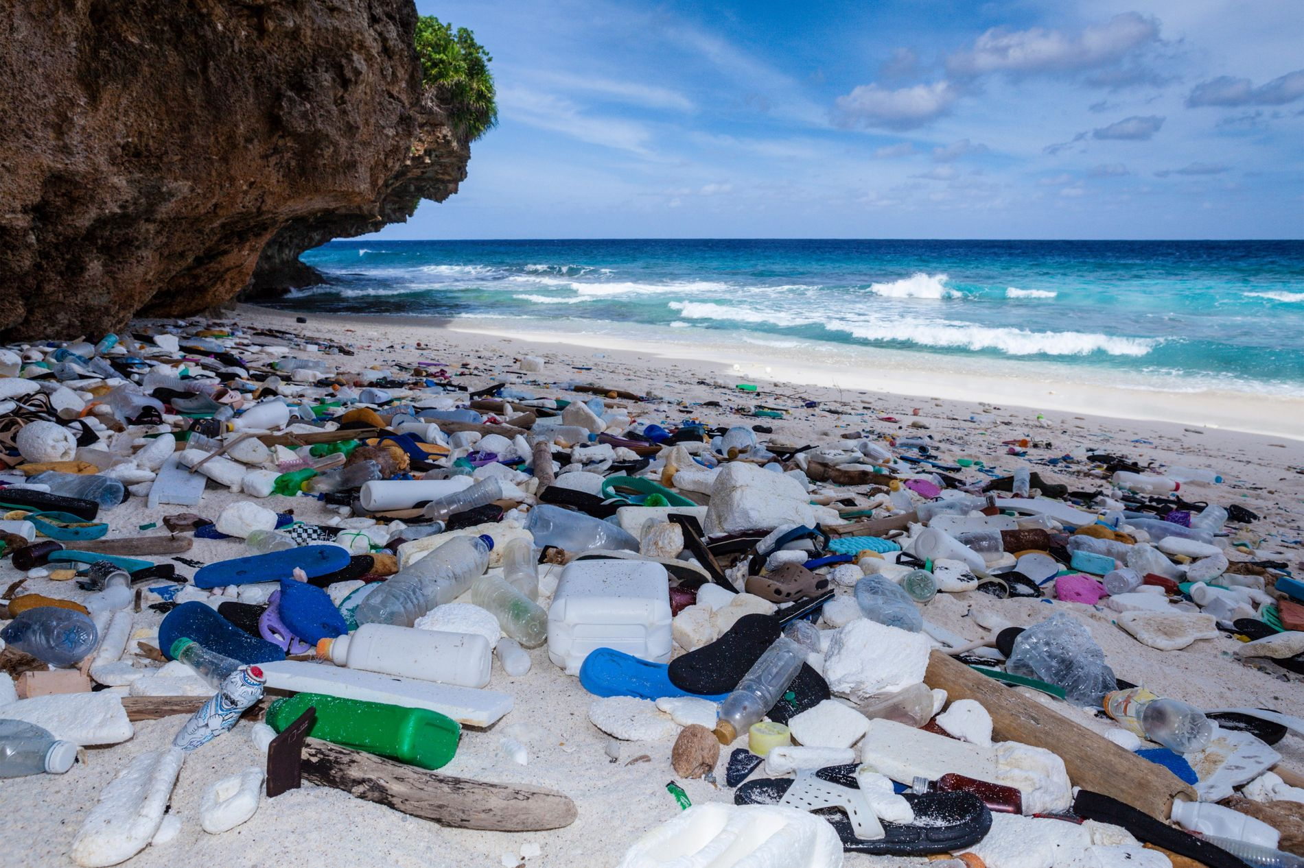 Washed up bottles, flip flops and other visible plastic waste on Christmas Island, Australia. The Ocean ...