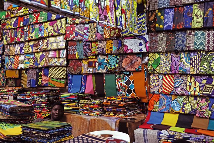 Shop selling a range of kitenge fabrics.