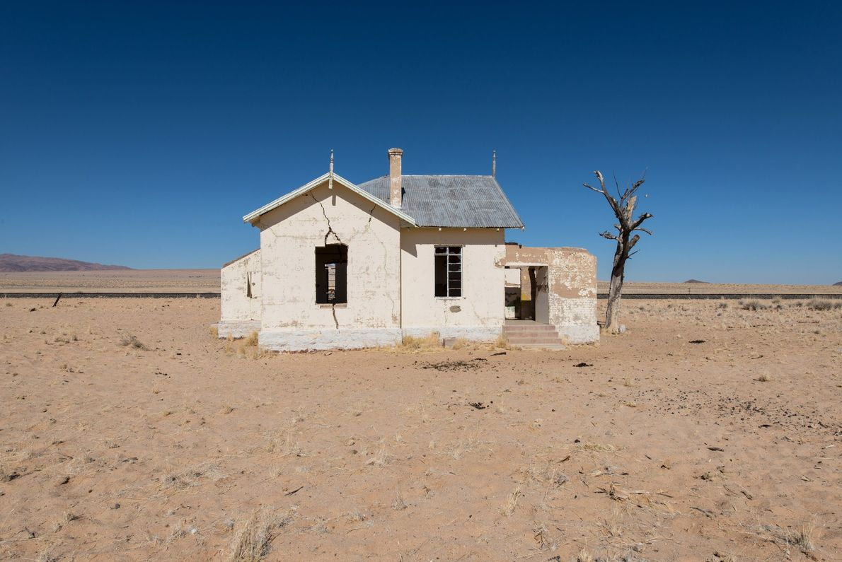 Water hauled in by rail once irrigated lawns and gardens in Kolmanskop. Now the abandoned town ...