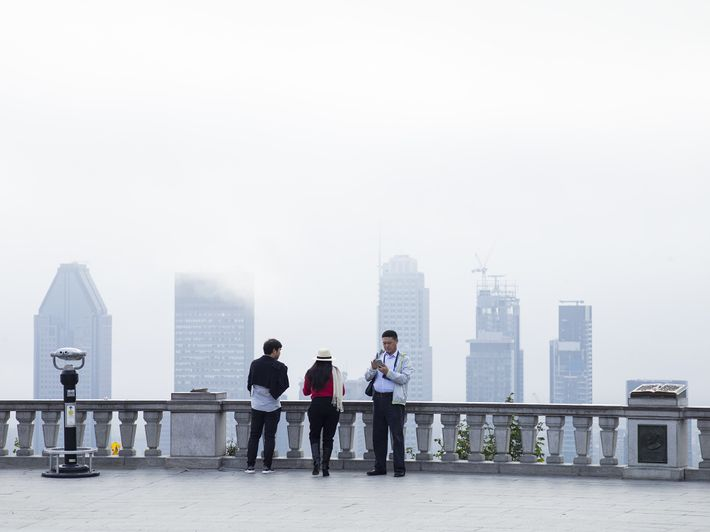 "Tourists take in the view from the Kondiaronk Belvedere in Mount Royal Park. ""We went very ..."