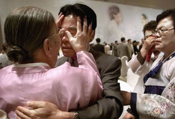 In August 2000, a South Korean woman touches the face of her North Korean son as ...