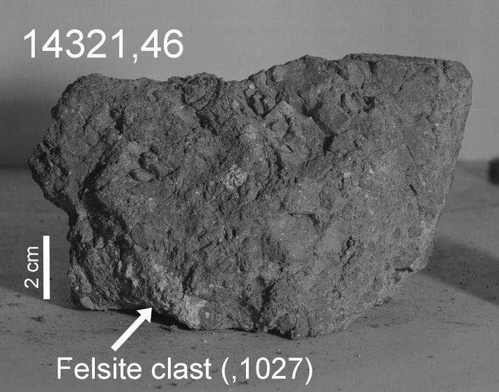 An arrow marks the light-colored portion, or felsite clast, of 14321 that researchers think formed on ...
