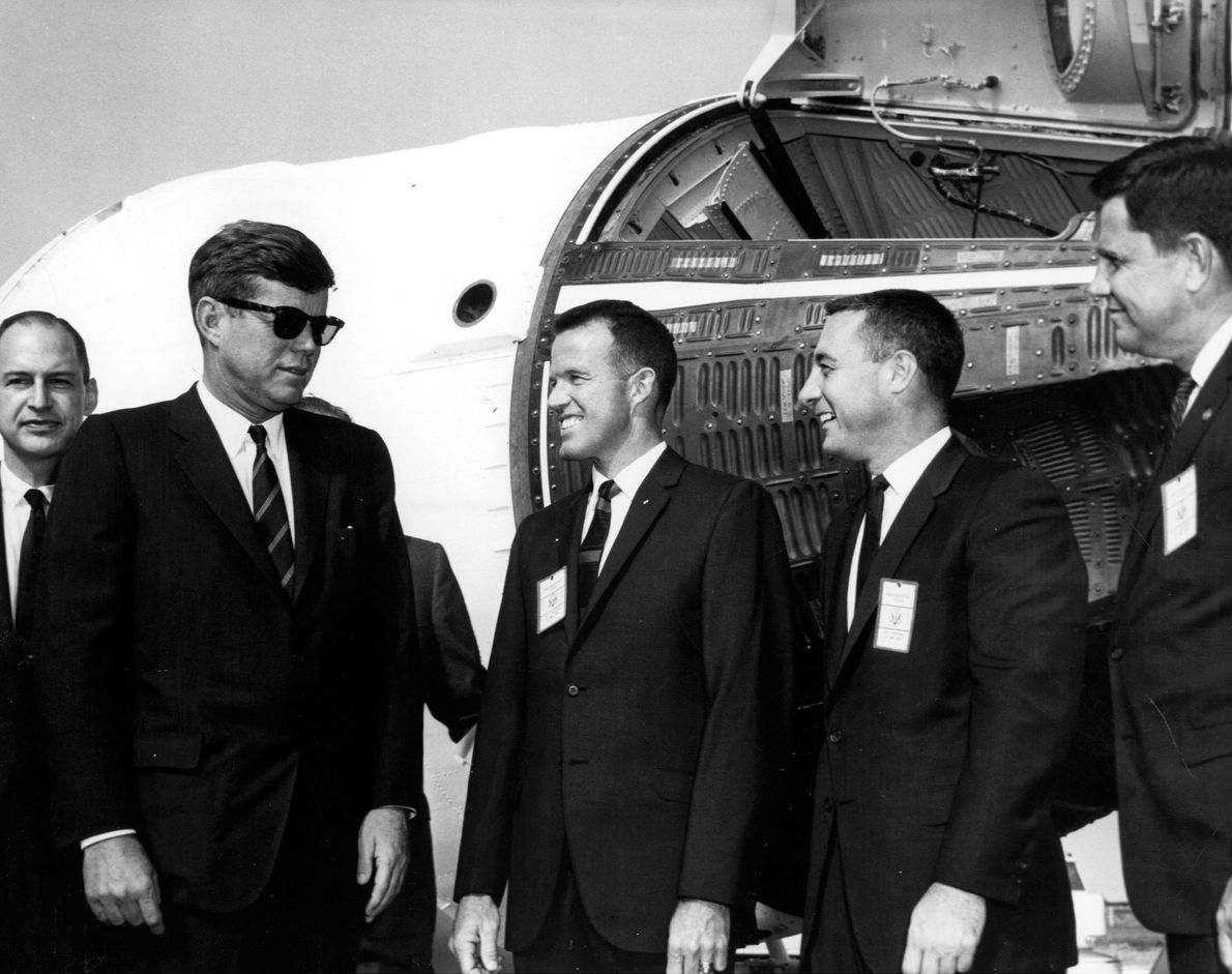 John F. Kennedy visits the Cape Canaveral spaceport, November 13, 1963. In this image he speaks with ...