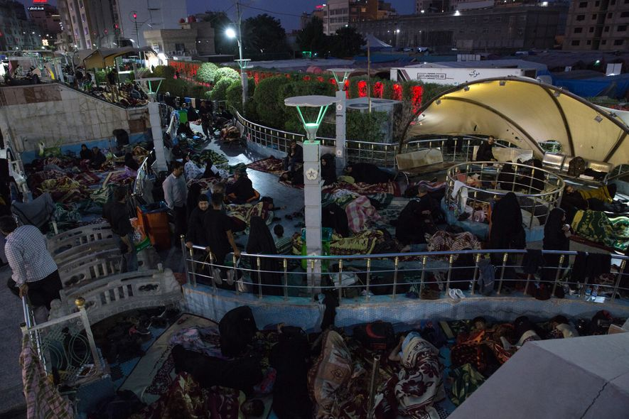 At night in Karbala, pilgrims sleep wherever they can - including rooftops, walkways, and vacant buildings.